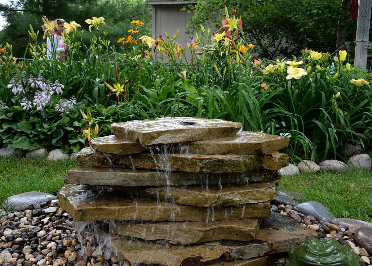 Decorative fountain in Phyllis McIntosh garden in Omaha