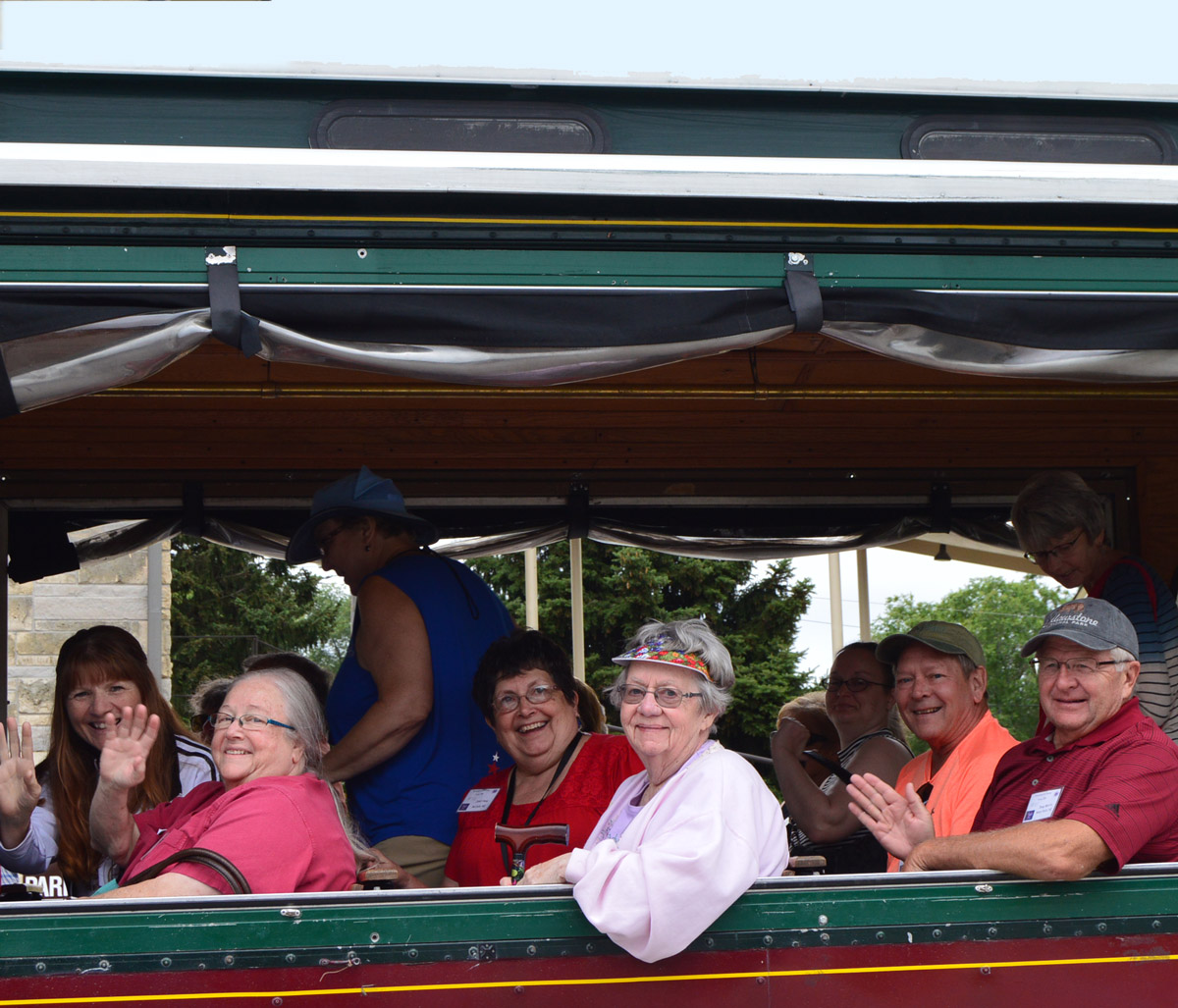 Attendees ride Ollie the Trolley up the hill to the Phyllis McIntosh garden