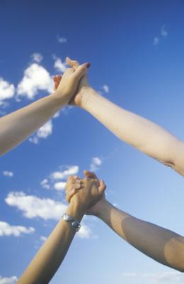clasped-hands-sky.jpg
