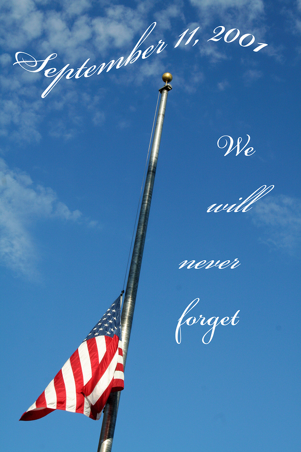 american flag flying at half staff against blue sky with september 11 2001 we will never forget enscribed over top