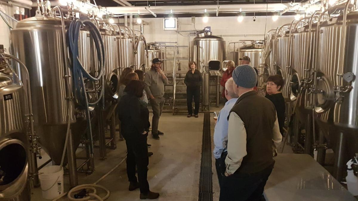 Image of people at a brewery tour.