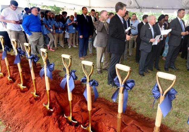 Cyber center groundbreak ceremony shovels