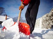 Resident shoveling snow.