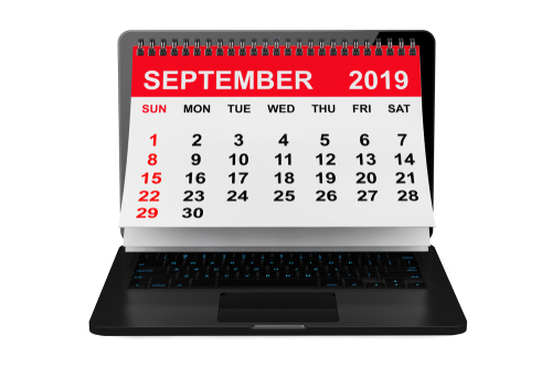 2019 year calendar. September calendar over laptop screen on a white background. 3d rendering