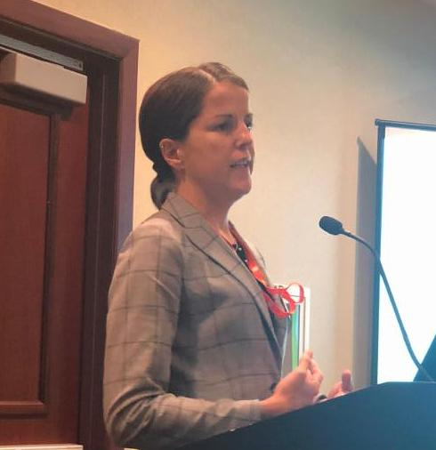 Photo of Noelle Ellerson Ng at podium