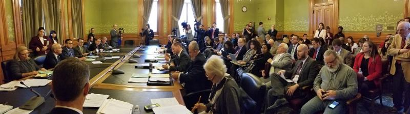 A packed room watches as the Senate Ways & Means Committee approves major income and corporate tax reform legislation.