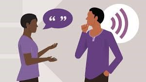 Picture of one person talking to another while the second person looks contemplative, representing active listening