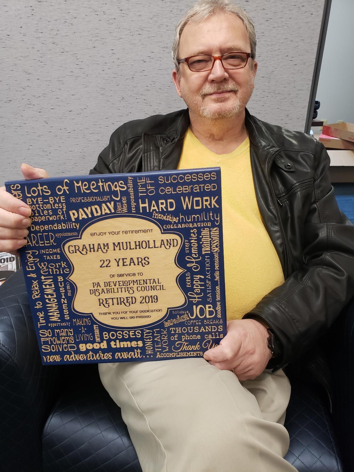 Graham holding plaque