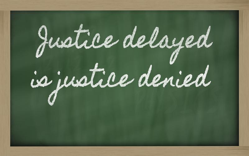 handwriting blackboard writings - Justice delayed is justice denied