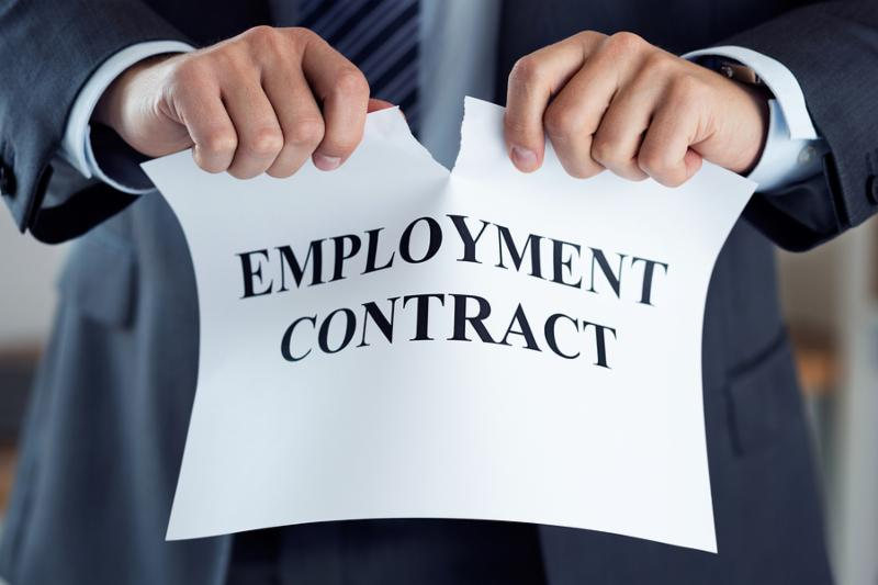 Close up of businessman hands breaking employment contract. Boss dismissing an employee. Bankruptcy redundancy and getting fired concept. Employee losing job or failing interview. Human resources