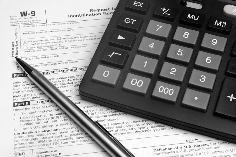 Pen and calculator on W-9 tax form