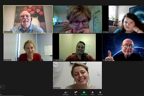 Image description. A screenshot of a group of seven people on a video call