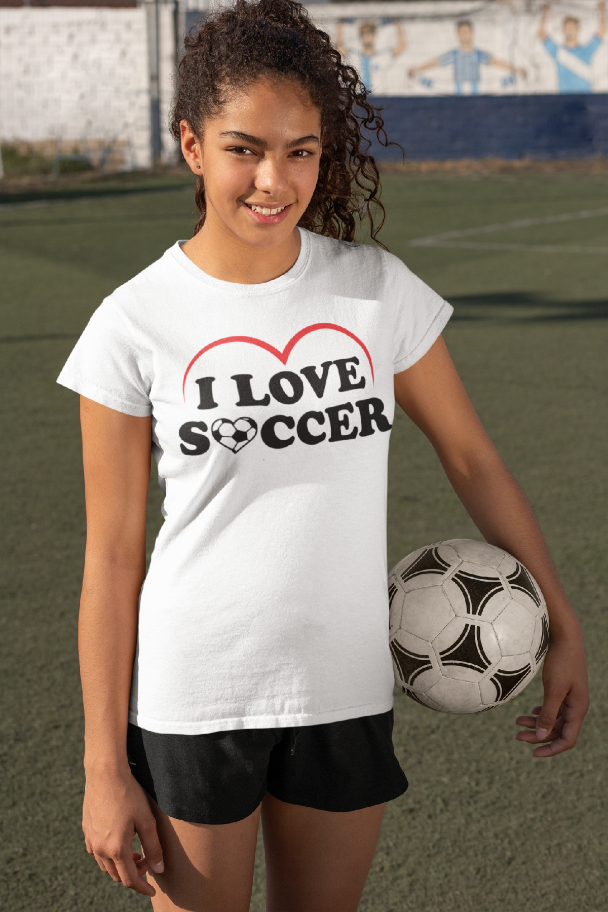 t-shirt-mockup-featuring-a-female-soccer-player-holding-a-ball-33577.png