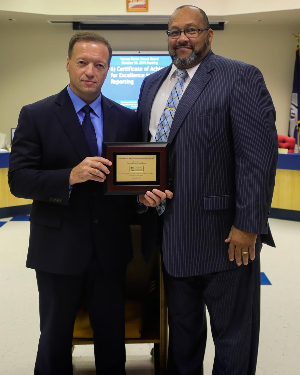 Tim Ward receives Certificate from VPSB President Vernon Travis.
