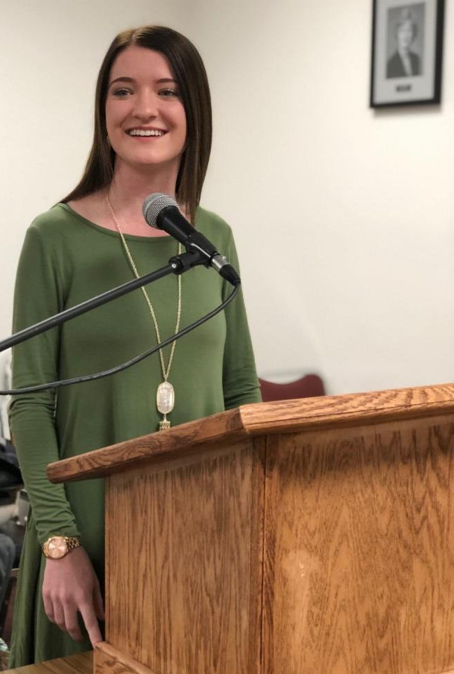 Beauregard Parish School Board Student Representative Courtney Smith addresses the board with news and updates from schools in the parish.