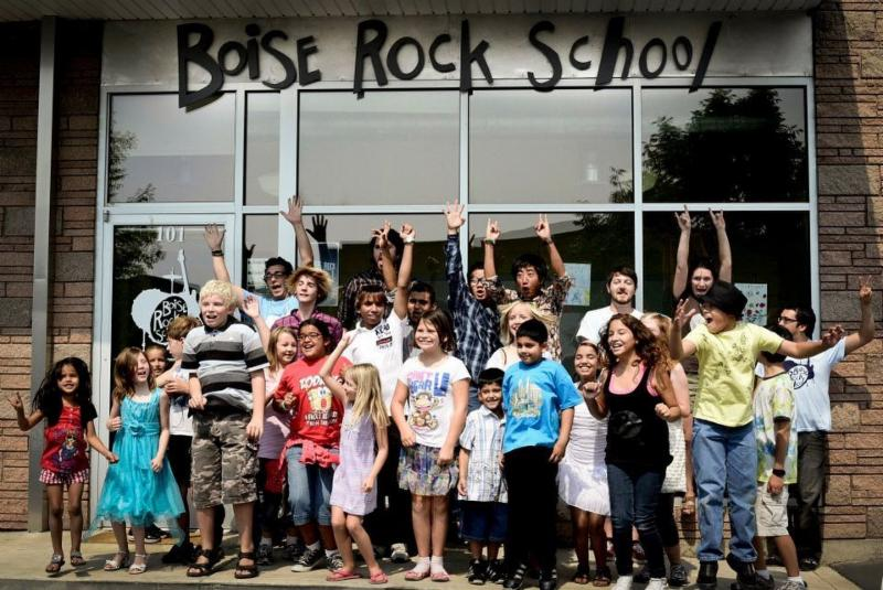 kids of all  ages and abilities in front of the entrance at Boise Rock School