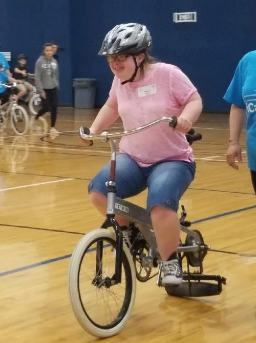 A girl learning to ride a bike