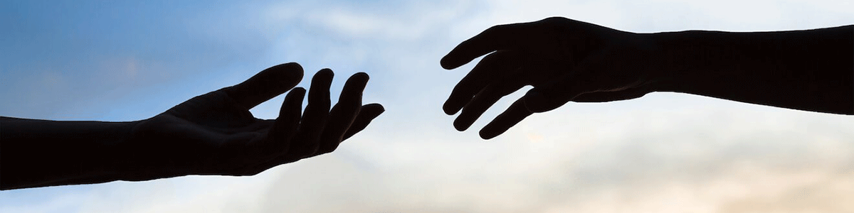 hands reaching out to each other