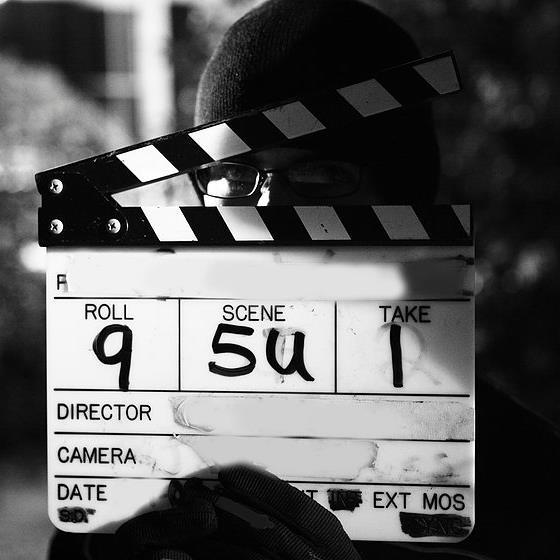 a man holds a camera slate