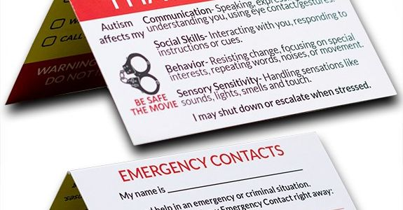 an emergency contact card showing information and a pair of handcuffs