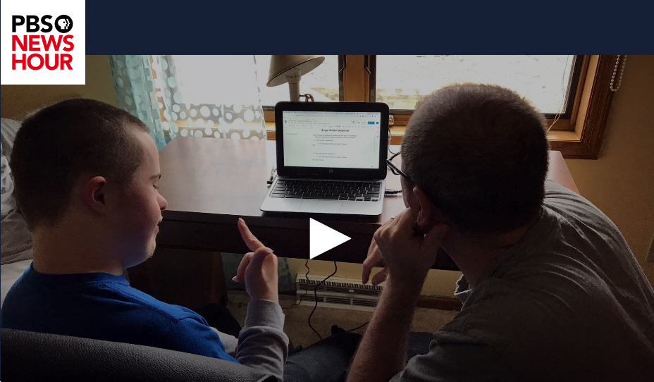 a father helps his son with distance learning