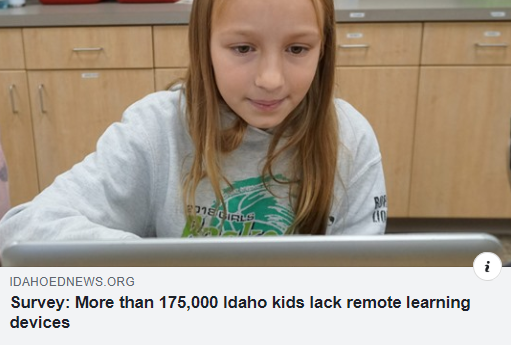 a girl looks at a computer