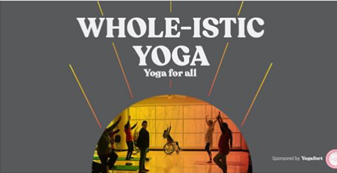 people in a yoga class with a person in a wheelchair in the center of the image