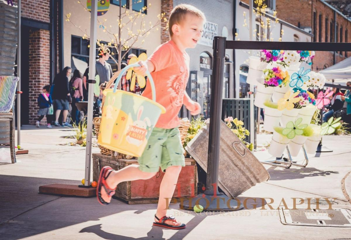 a boy running with an easter basket