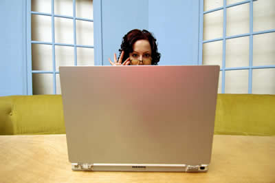 woman behind large laptop