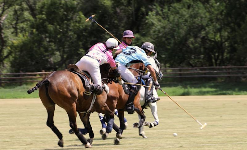 Carlitos Gracida of La Karina out of the saddle to hook Nacho Novillo Astrada.