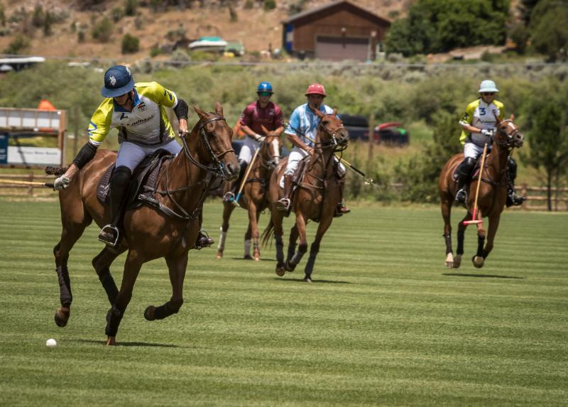Juancito Bollini of Mountain Chevrolet drives downfield in his summer debut.