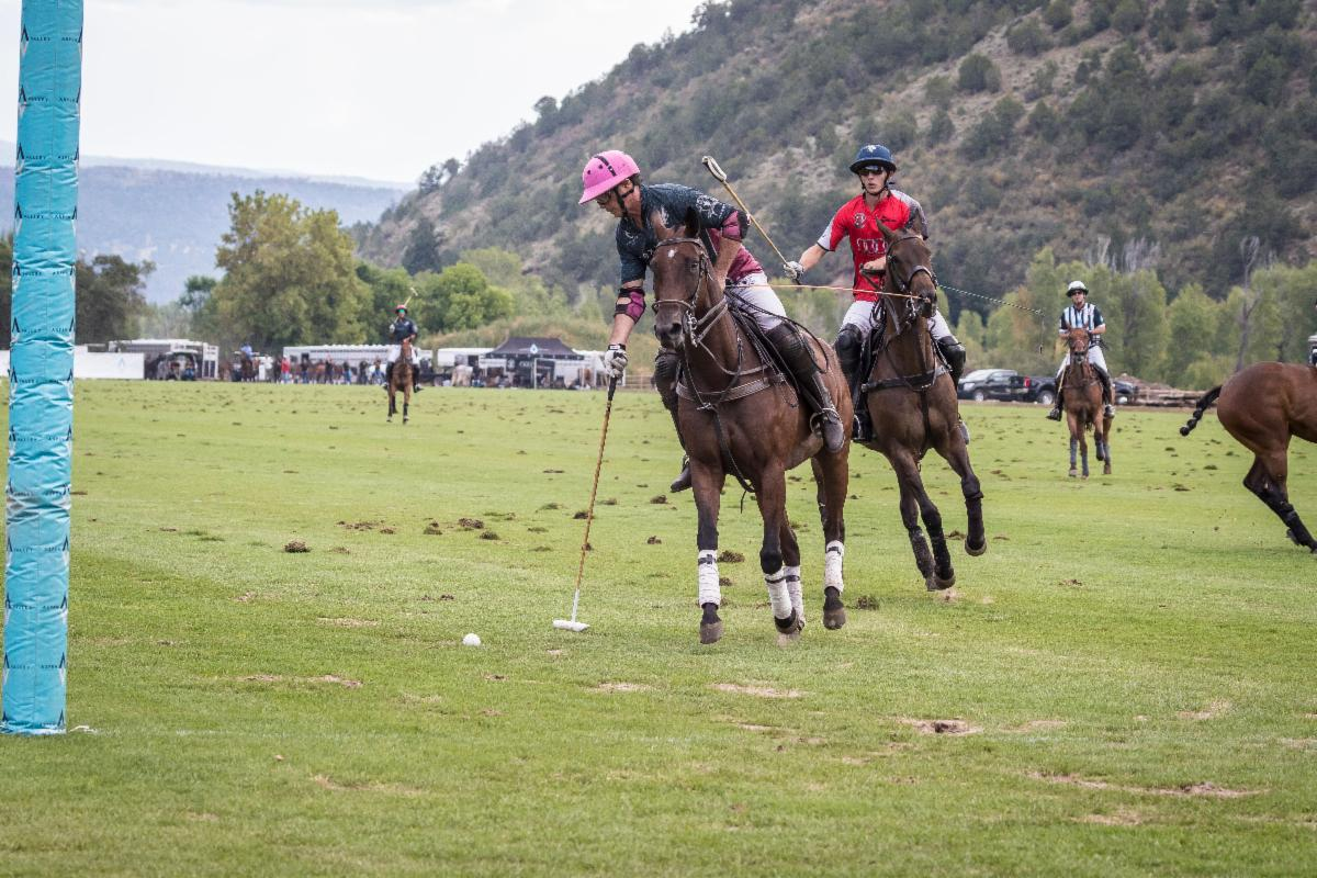 Juan Bollini of Flexjet saves a goal attempt by his son Juancito Bollini of Audi.
