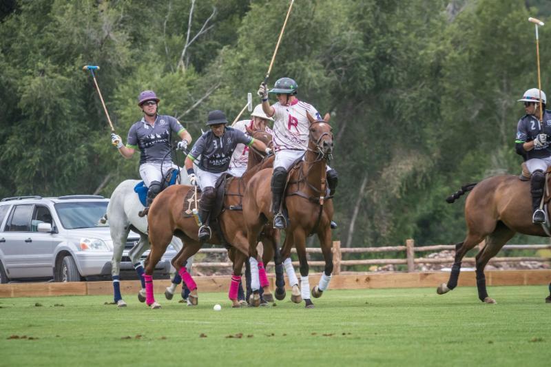 Sebastian Merlos of La Karina hits past Nic Roldan.