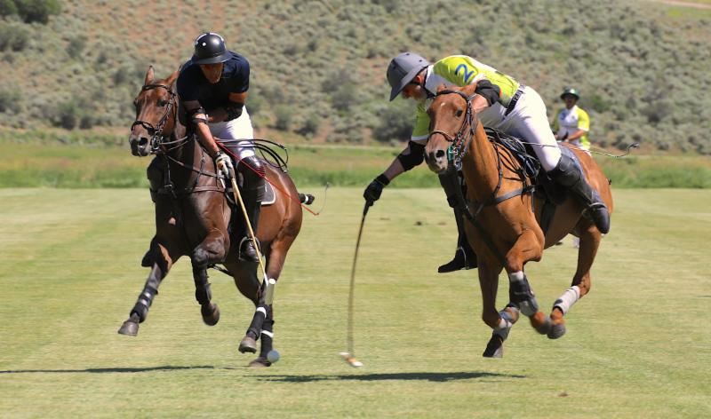 Tom Barrack of Piocho Ranch and Michael Payne of Mountain Chevrolet go for the ball.