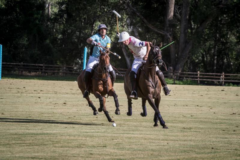 Nacho Novillo Astrada of Casablanca reaches to hook Stewart Armstrong of McClure River Ranch.