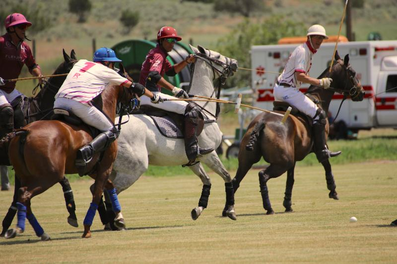 Hilario Figueras of McClure River Ranch reaches for the ball.