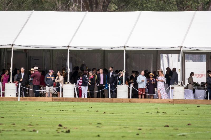 A sold out VIP tent for the Chukkers_ Champagne _ Caviar fundraiser for the Aspen Valley Hospital Foundation enjoy a day of polo.
