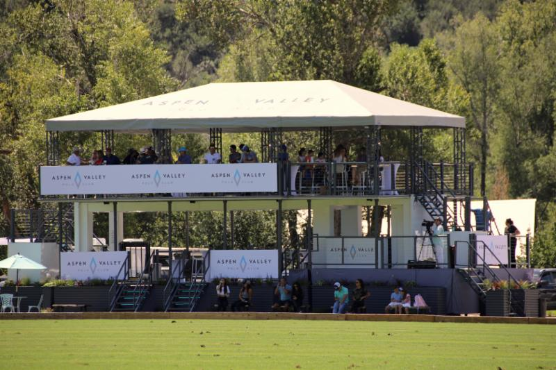 Fans enjoy opening game action of the 119th USPA Silver Cup in the new stadium seating at McClure River Ranch.