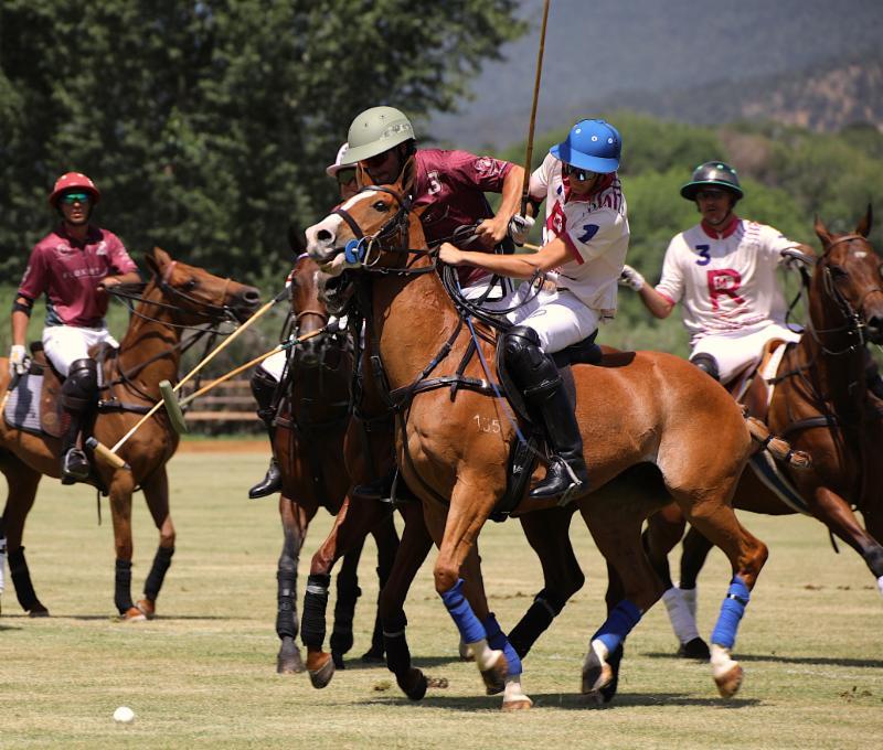 Salvador Ulloa of Flexjet and Hilario Figueras battle for the ball.