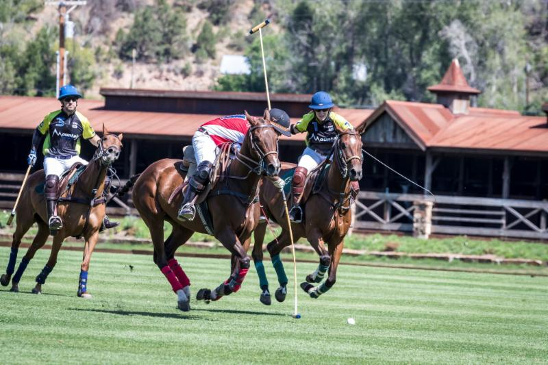 Gabriel Gracida of Los Amigos Red works the near side with Lauren Sherry of Mountain Chevrolet defending.