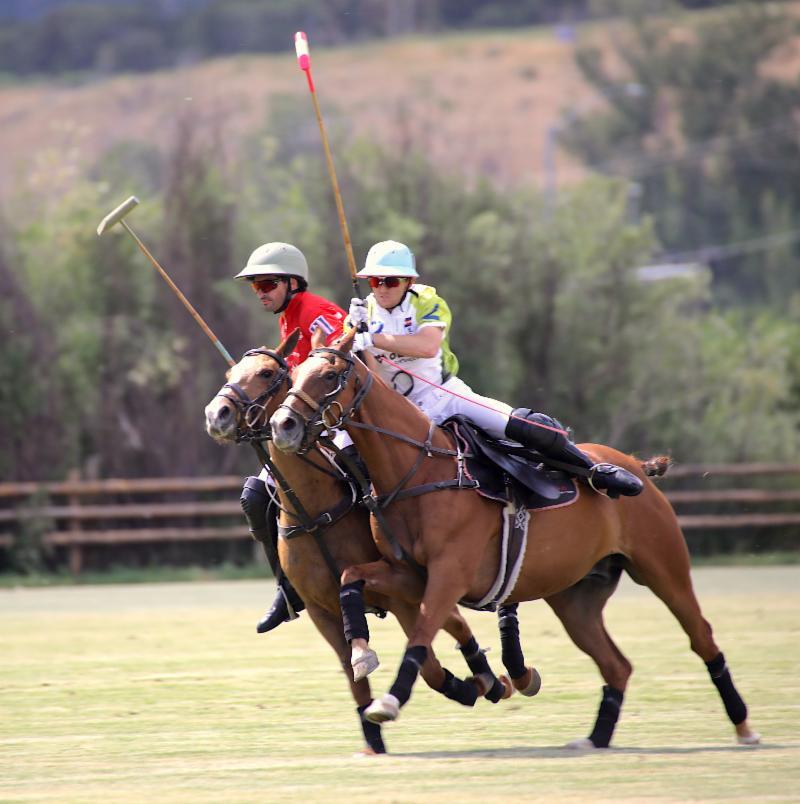 Grant Ganzi of Mountain Chevrolet rides off Salvador Ulloa of Los Amigos Red
