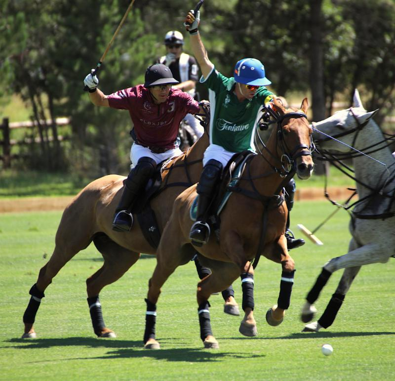 Sapo Caset of Tonkawa goes for the big hit with with Hilario Ulloa of Flexjet defending.