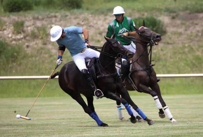 Nacho Figueras of Piocho Ranch works the ball with Tommy Collingwood of Sopris Mountain Ranch defending.