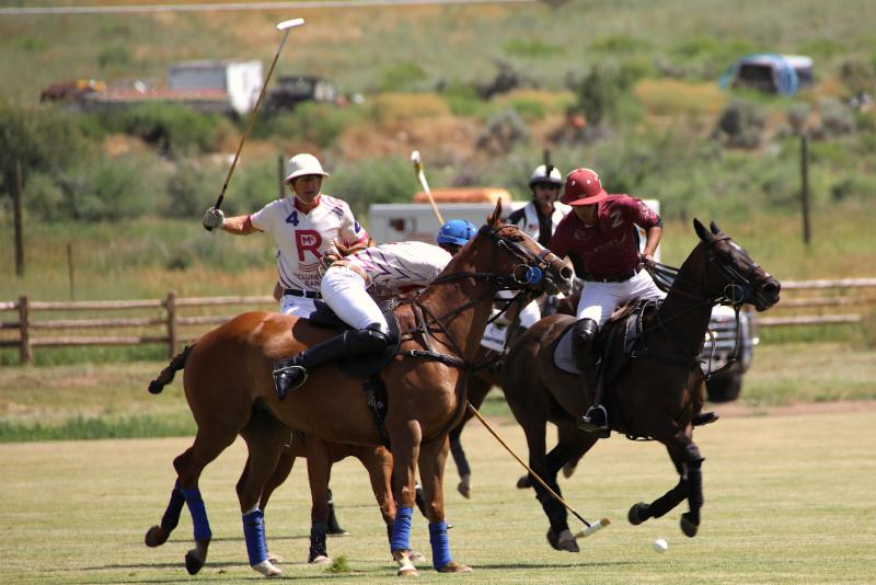 Hilario Figueras of McClure River Ranch reaches to steal the ball from Alejandro Novillo Astrada.