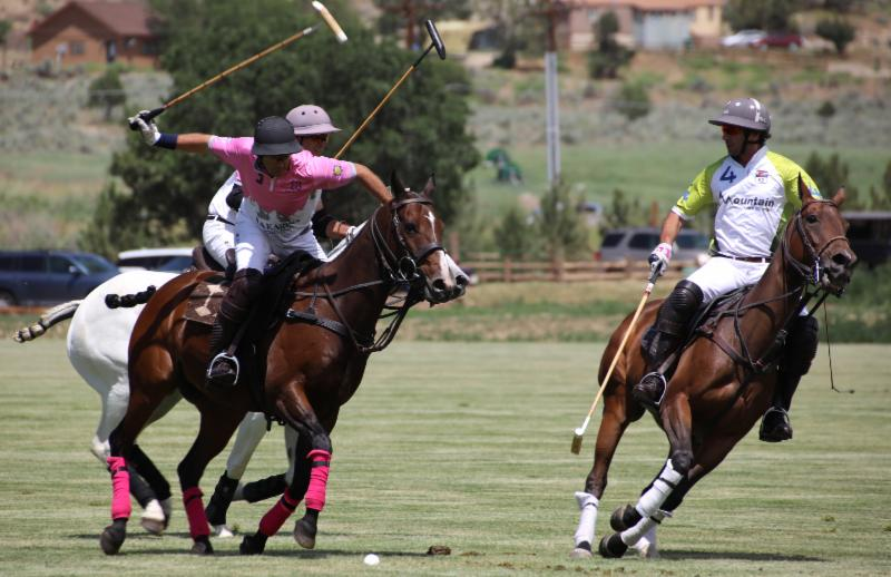 Sebastian Merlos of La Karina tries to get the ball past Nacho Novillo Astrada of Mountain Chevrolet.
