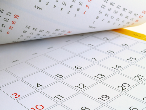 desk calendar with days and dates in July 2016_ flip the calendar page