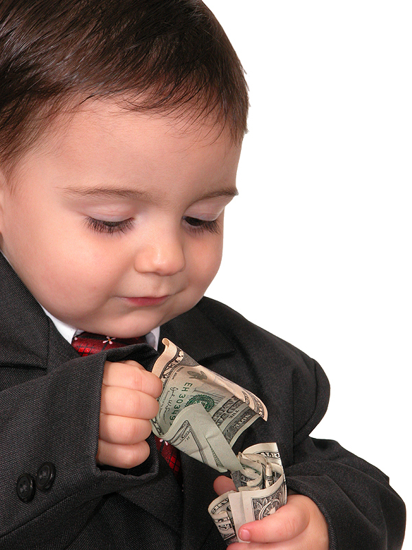 Small boy counting his money.  US bills.  Shot on white.