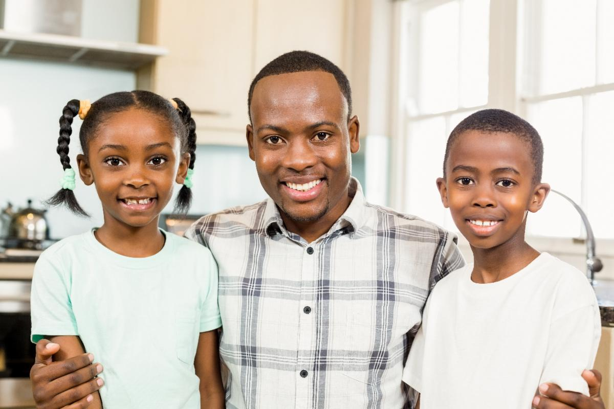 Black father with daughter and son