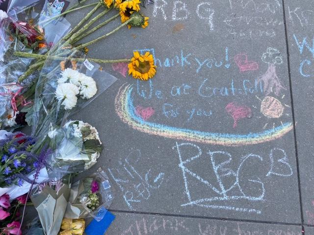 Flowers and messages in chalk for Justice Ginsburg