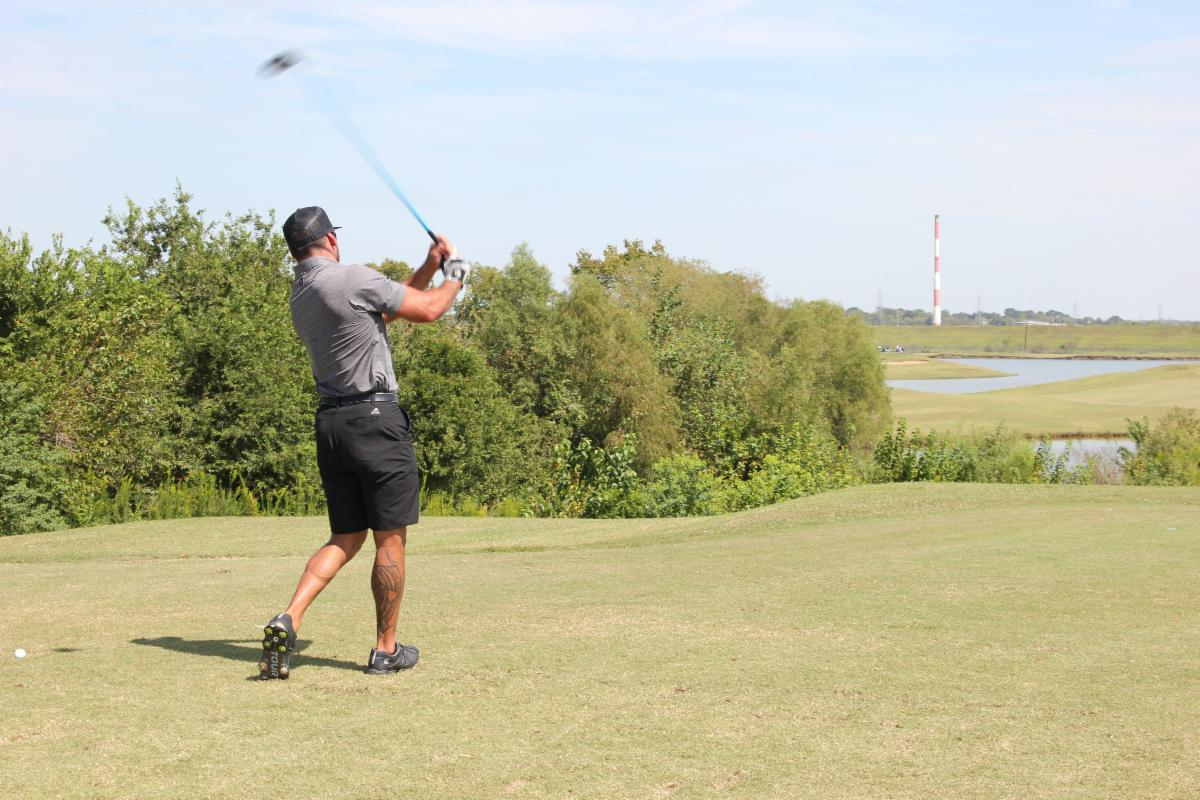 A golfer swinging a club